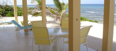 Wrap Around Porch with Out Door Dining and Lounge Chairs
